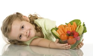 Little girl with a bowl of vegetables