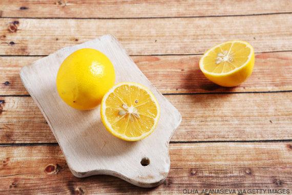 Yellow lemon on cutting board